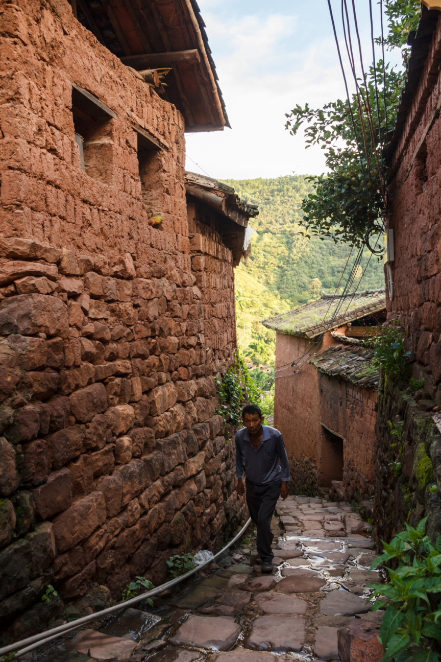 man in old chinese village in yunnan province